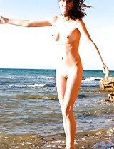 Nansy goes all the way posing and stripping at the seashore